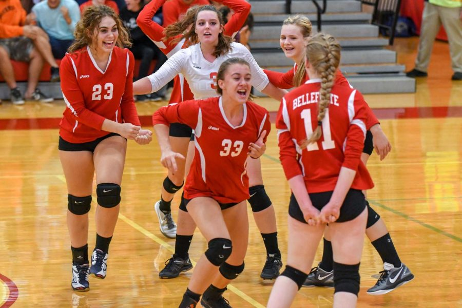 The volleyball team celebrates a point