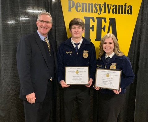 Seniors Ryan Smith and Gretchen Little at the PA Farm Show.