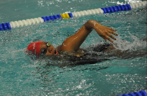 Freshman+Maijanai+Johnson+swimming+in+her+event+during+the+winter+season