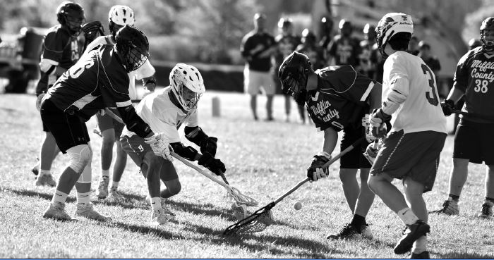 Members+of+the+boys%E2%80%99+lacrosse+team+fight+for+a+ground+ball+against+Mifflin+County.+