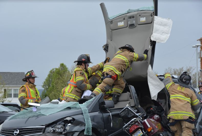 Members of the Logan Fire department disassemble a wrecked vehicle to demonstrate the intense process of extracting victims from a car crash.