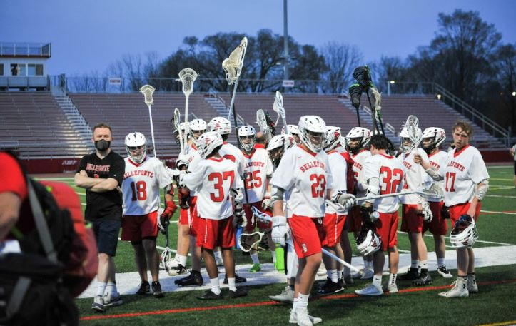 Boys Lacrosse team breaks from a huddle during a home match at Roger Stadium.