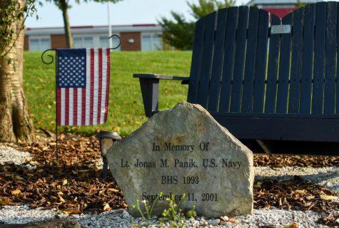 A memorial rock sits in front of the school to honor Lt. Jonas M. Panik.