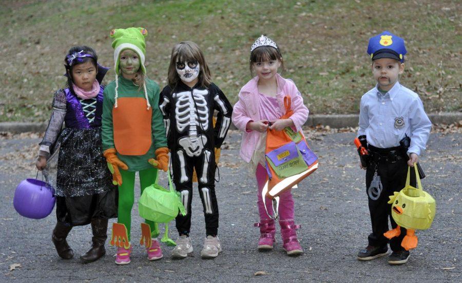 Kids dress up in fun, festive Halloween costumes.